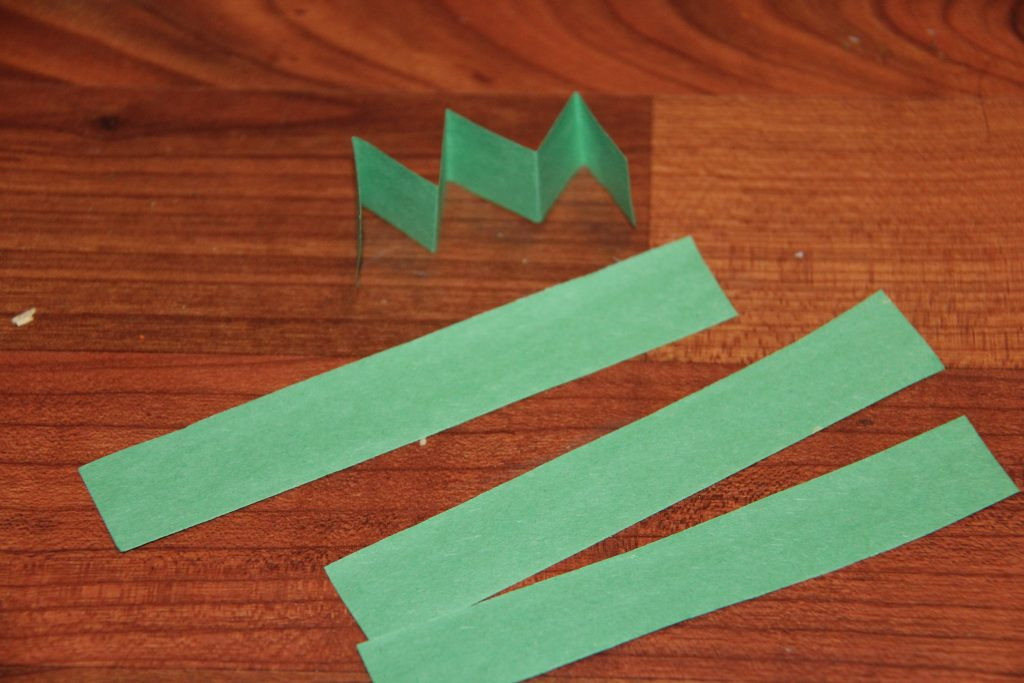 Create a simple handprint Leprechaun craft for kids. It is a perfect last minute St. Patrick's Day craft for kids that they will have fun playing with.