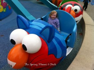 Willow in the Elmo Flying Fish Ride at Sesame Place