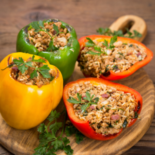 healthy stuffed peppers on a cutting board