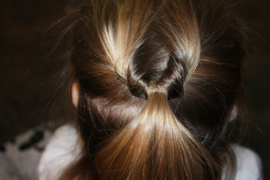 Turn the pony tail upside down for the heart hair style