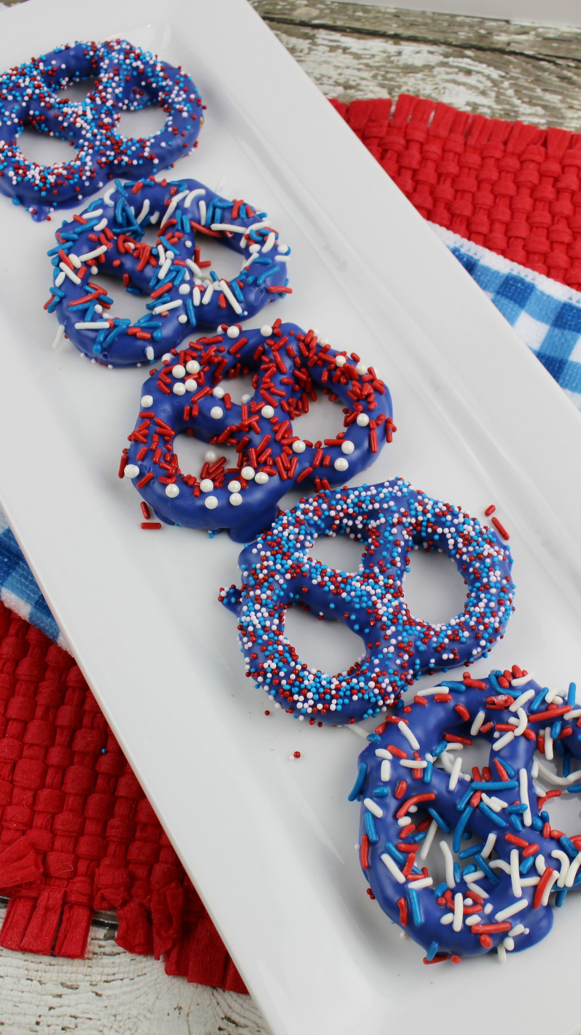 Patriotic preztels are a great addition to any picnic. It is a simple chocolate covered pretzel dessert that the kids will love helping to make.