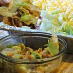 Looking for a recipe to take to your next picnic, potluck or party? Taco Dip is always a hit. Simple to make and taste delicious, everyone will want it.