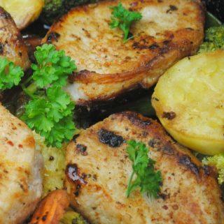asian pork chops in a cast iron skillet for vegetables
