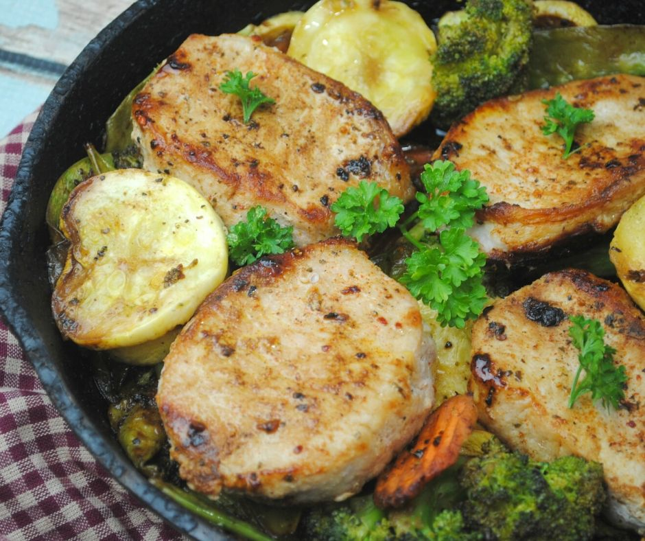 asian pork chops in a cast iron skillet for vegetables