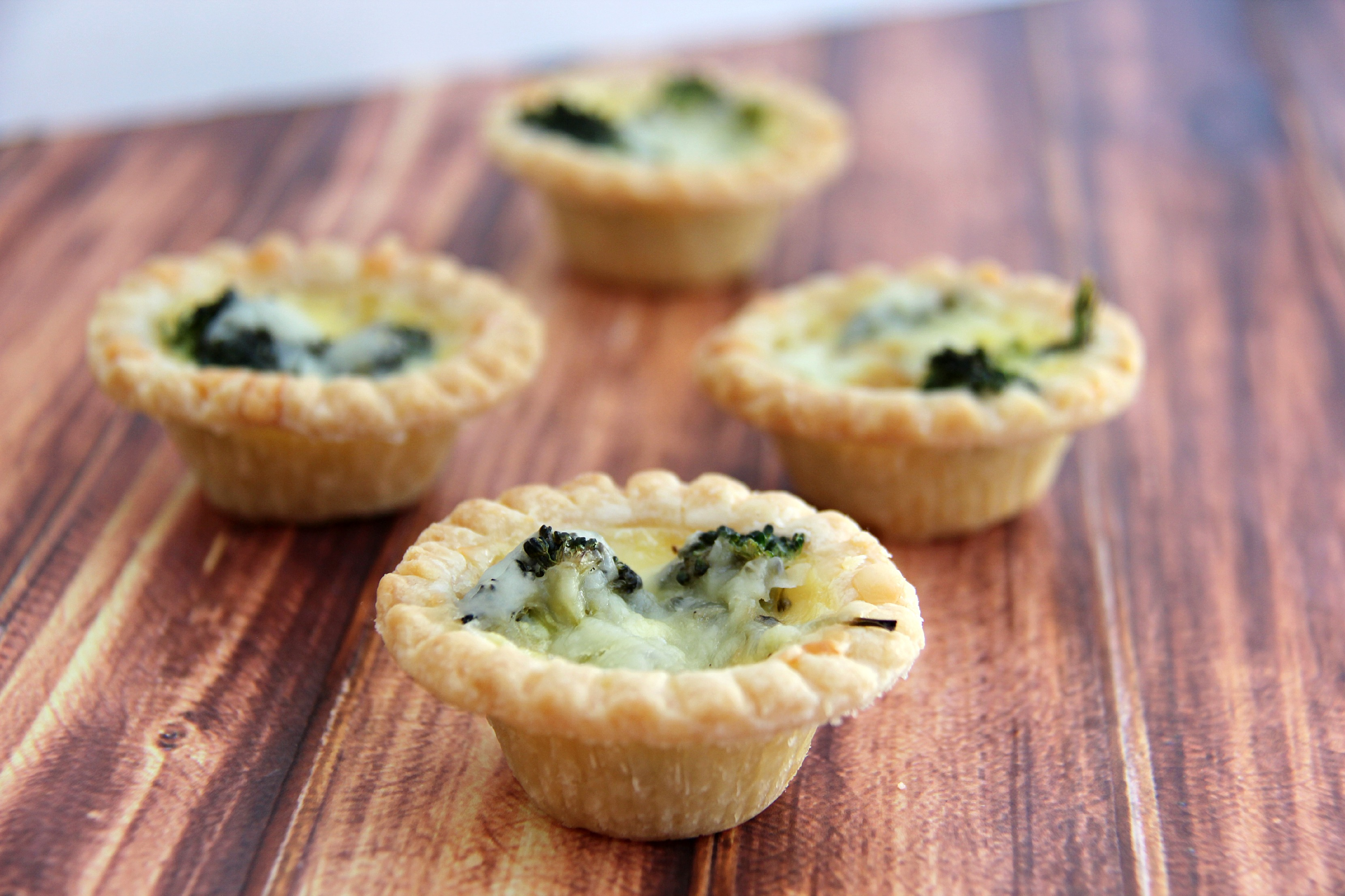 Broccoli and Cheddar Mini Quiches are a cheap dinner recipe that taste fantastic.