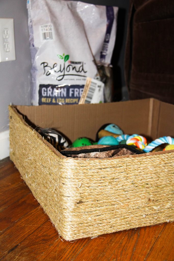 Have a spoiled dog with lots of toys? Make this simple dog toy box using rope, and a box. DIY a toy container that looks like it came from a pet store.