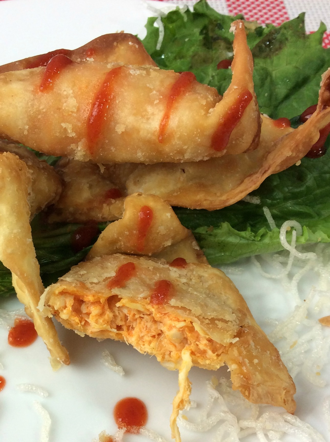 The Cheesecake Buffalo Blasts copycat recipe is filled with Chicken, Cheese and Spicy Buffalo Sauce in a fried wonton wrapper. It is fried to add the perfect amount of crunch.