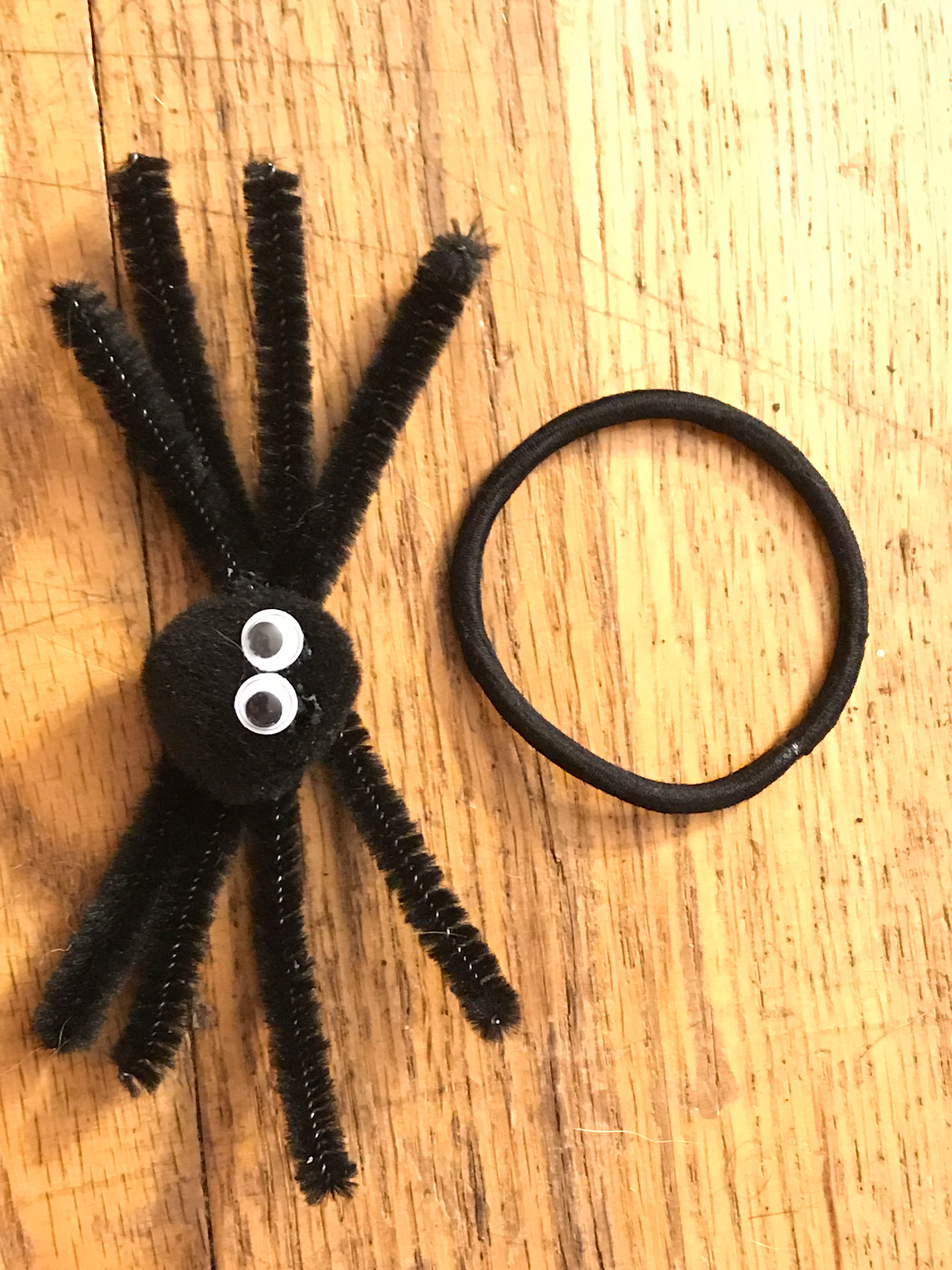 A simple Halloween hair style. Create a fun spider craft that can double as a Halloween hair accessory. We created Halloween hair ties and Halloween barrette with our spiders.