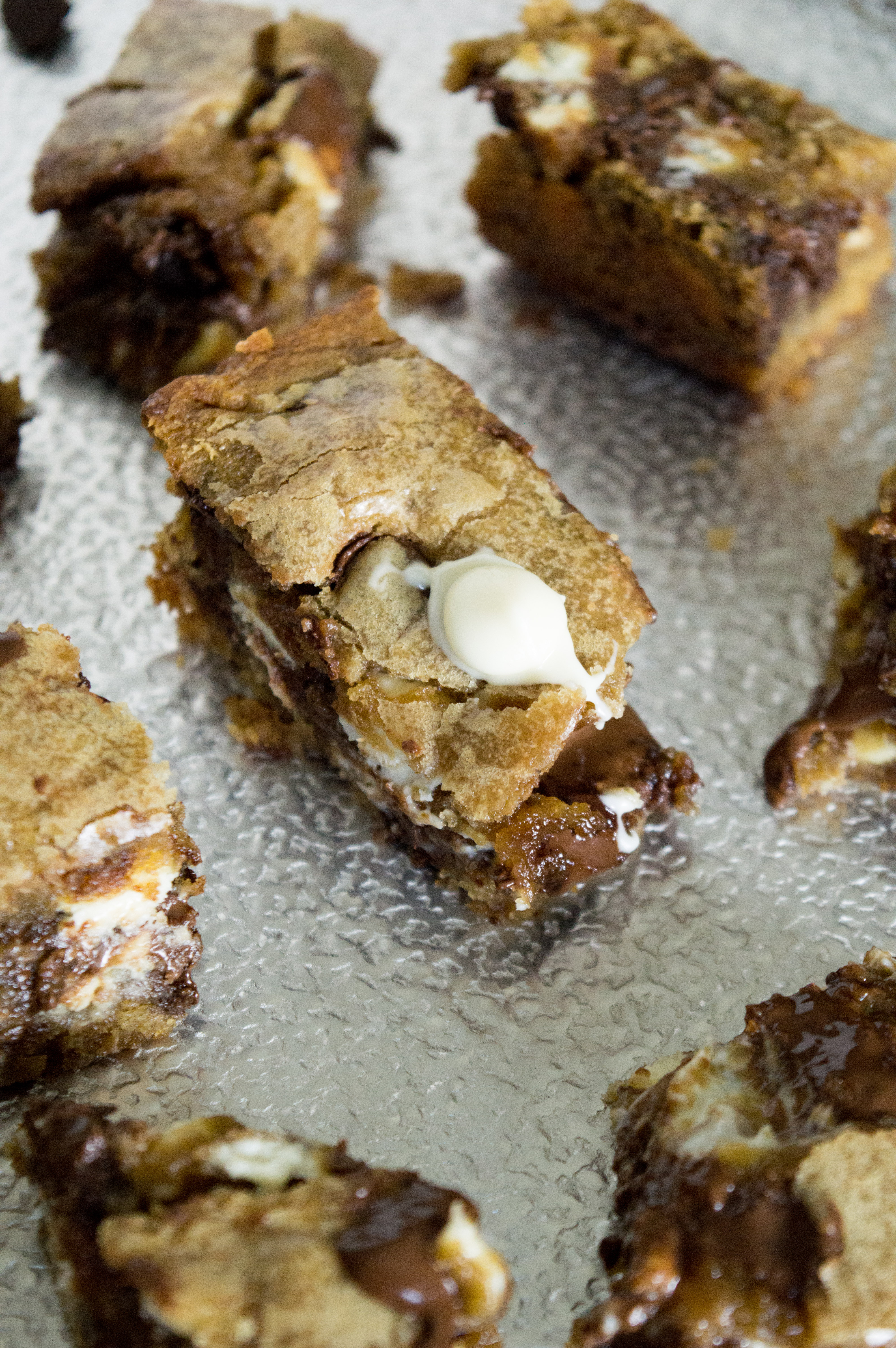 Looking for a Nutella cookie recipe? Look no farther. These Nutella Chocolate Chip Sugar Cookie Bars are so good and take cookie bars to a new level.