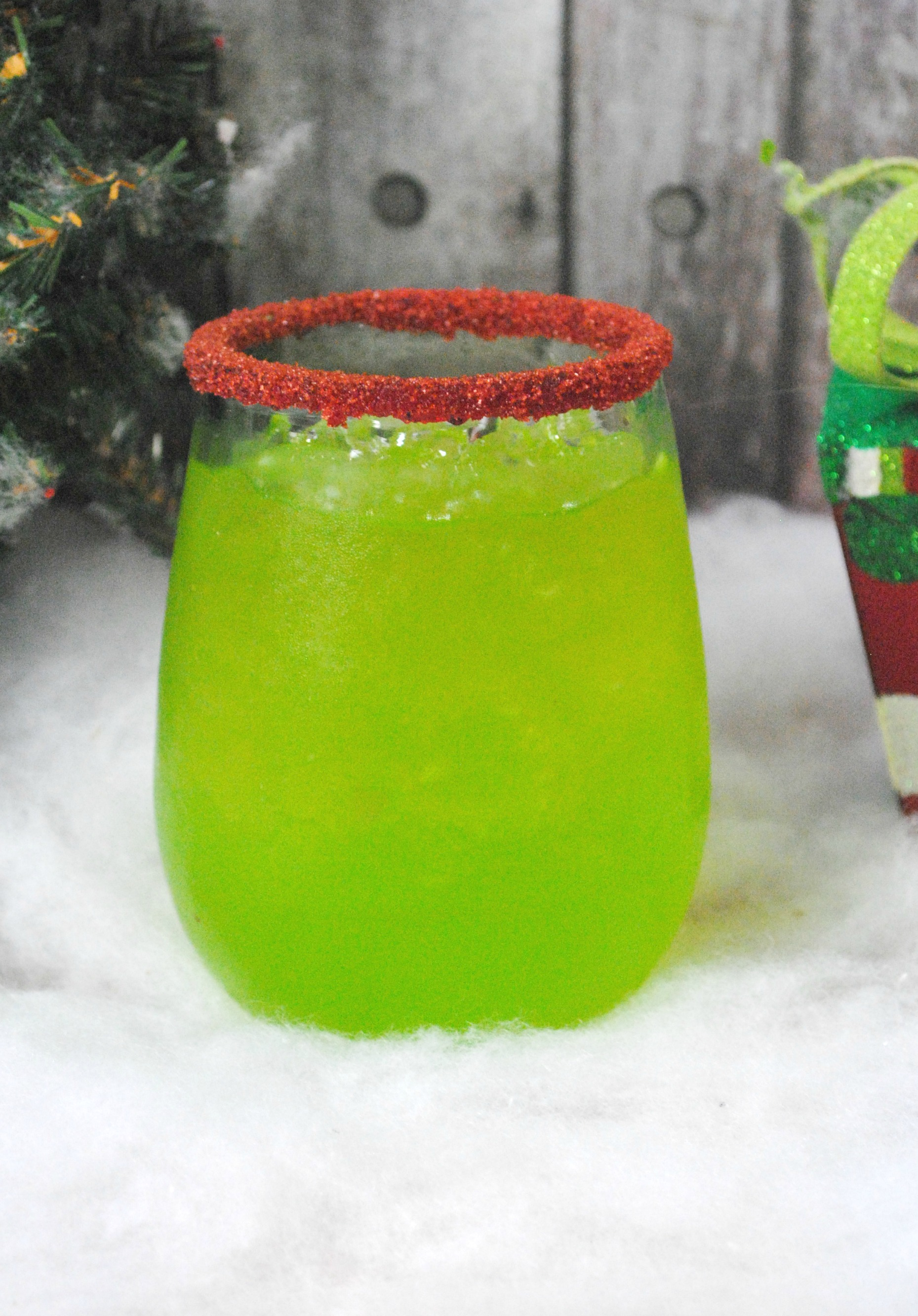 Green Christmas drink with red sanding sugar, Grinch Cocktail