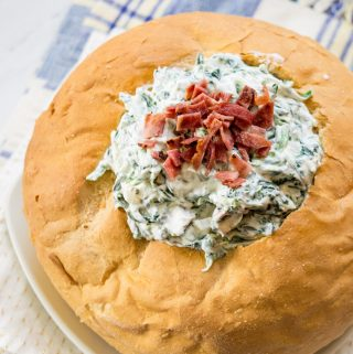 Love spinach dip? So do I. This spinach dip recipe, an easy pot luck recipe, will leave you craving more once you add my special ingredient. Bacon!