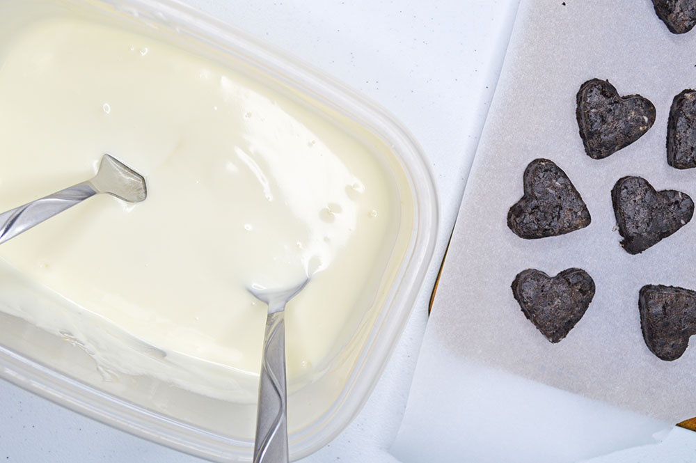 Melt the chocolate to dip the heart truffles in
