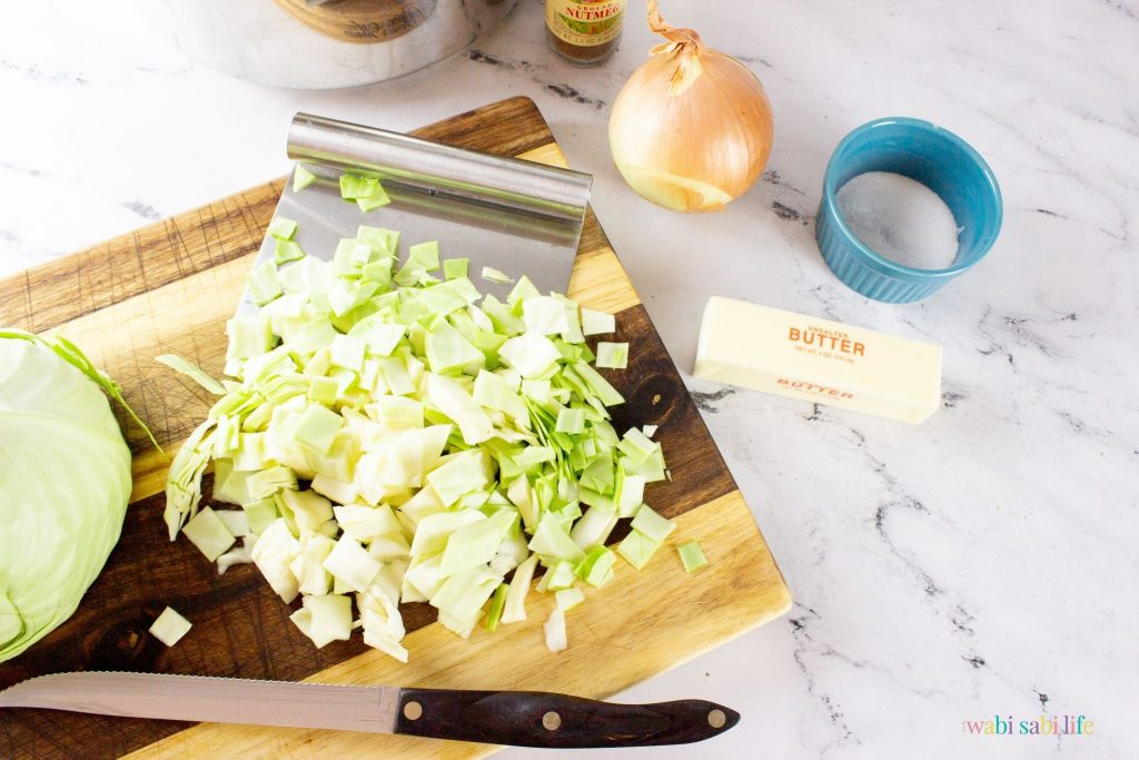 Sliced cabbage on a wooden cutting board