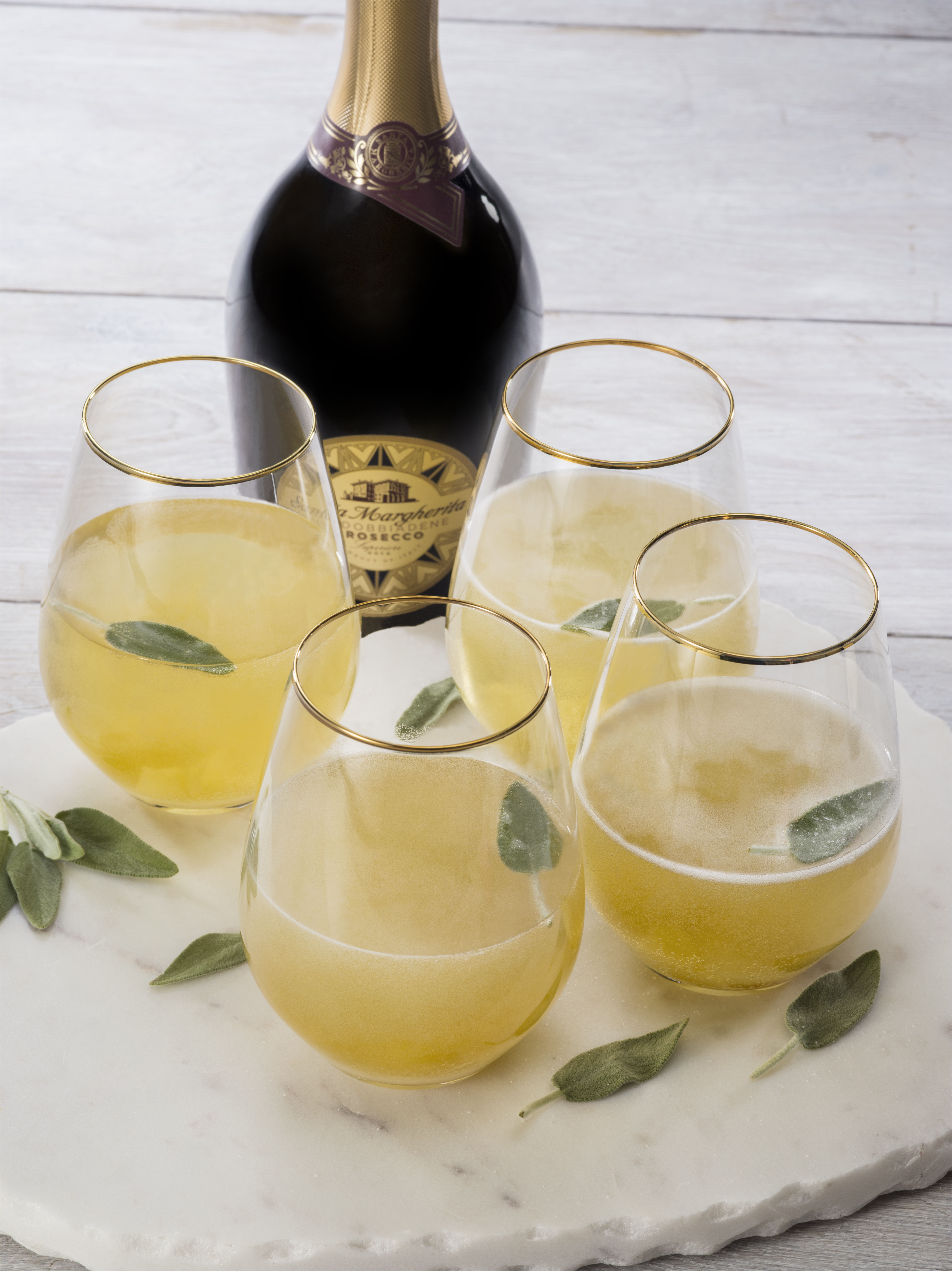 4 glasses of ginger sage cocktail that is perfect for brunch cocktails