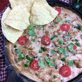 Looking for a good cheese dip recipe? I have just what you need. This Cowboy Queso Dip recipe is perfect if you are looking for a spicy cheese dip or a cheese dip with meat in it. This is going to be a crowd pleaser recipe for any picnic or get together.