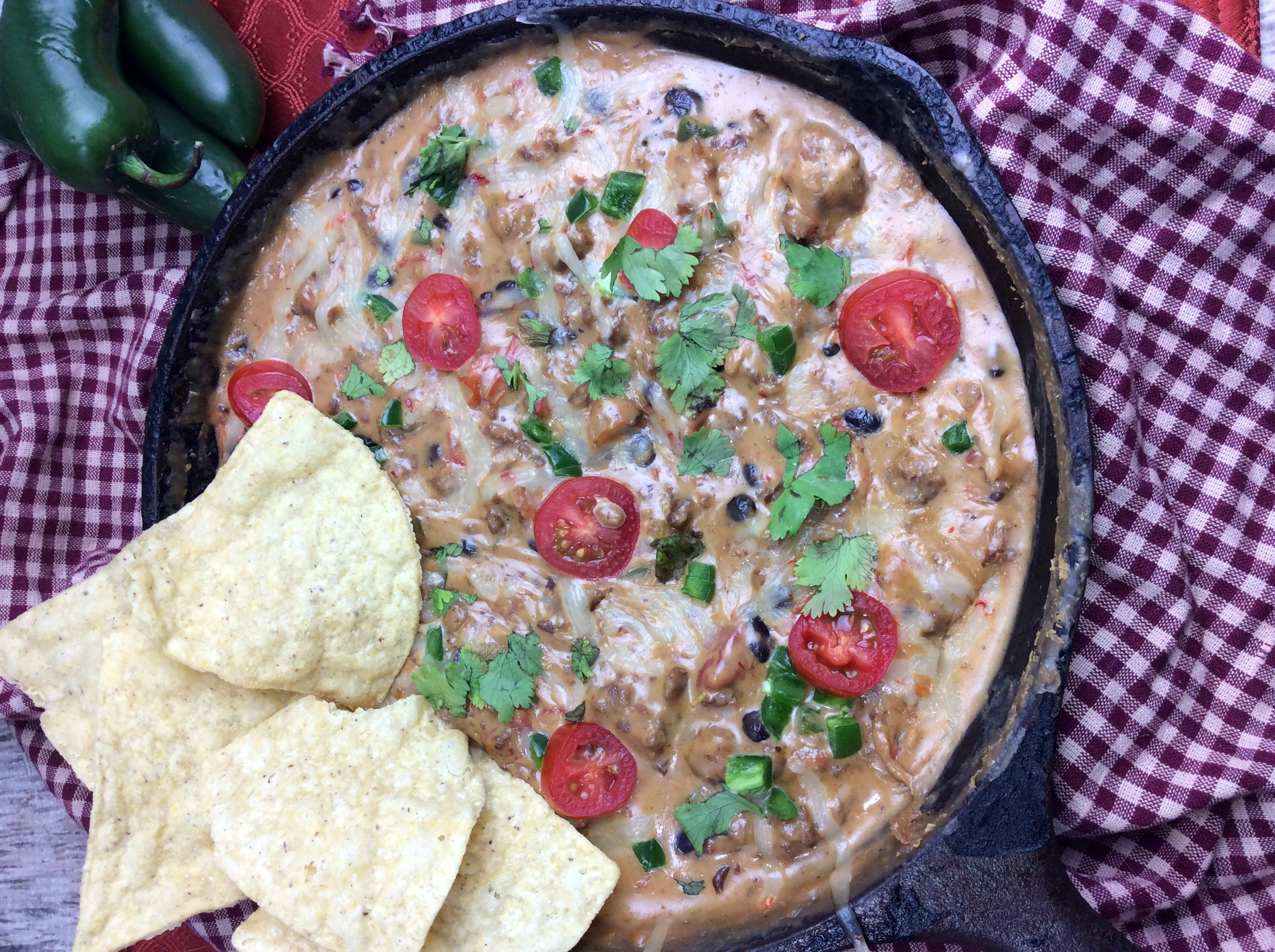 "Cowboy Queso dip Ingredients 1/2 lb. hot pork sausage salt and pepper to taste 1/4 cup of chicken broth 16 oz. Velveeta, cut into 1"" cubes 1/2 c. Shredded Pepper Jack cheese 1 (14.5-oz) can Rotel Tomatoes, undrained 1 cup black beans, drained and rinsed 1/4 cup chopped fresh cilantro 1-2 diced jalapeños seeds removed Directions: Browning the sausage in a medium skillet over medium heat. Crumble your sausage as you cook it. Looking for a good cheese dip recipe? I have just what you need. This Cowboy Queso Dip recipe is perfect if you are looking for a spicy cheese dip or a cheese dip with meat in it. This is going to be a crowd pleaser recipe for any picnic or get together. When the sausage is cooked add in the chicken broth and allow to cook down/reduce for 3-4 minutes, stirring occasionally. Now add your cheese and stir to combine. Looking for a good cheese dip recipe? I have just what you need. This Cowboy Queso Dip recipe is perfect if you are looking for a spicy cheese dip or a cheese dip with meat in it. This is going to be a crowd pleaser recipe for any picnic or get together. It should take about 4-5 minutes for all the cheese to melt in. Once melted, stir in the tomatoes, beans, jalapeños and cilantro. Looking for a good cheese dip recipe? I have just what you need. This Cowboy Queso Dip recipe is perfect if you are looking for a spicy cheese dip or a cheese dip with meat in it. This is going to be a crowd pleaser recipe for any picnic or get together."