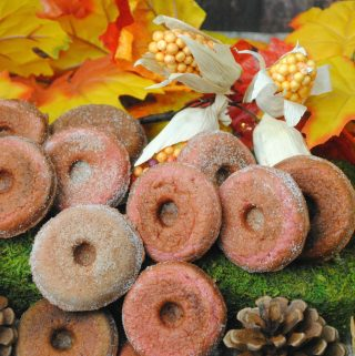Apple Cider Donut Ingredients: 4 TBSP unsalted butter, melted and cooled ½ c apple cider 1 C flour 1 tsp baking powder ½ tsp cinnamon ¼ tsp nutmeg ¼ tsp salt ⅓ C sugar 1 egg, room temp These donuts are a delicious twist on an apple recipe. Using Apple Cider, the taste of these Apple Cider donuts is amazing. Making the donuts: Preheat oven to 425 degrees. In a double boiler, melt the butter. Remove from heat and stir in the apple cider. Set this aside. Add all of your flour, baking powder, nutmeg, and salt in a bowl, mix well. Transfer the butter mixture to a bowl, whisk in sugar and the egg, lightly beaten. When completely mixed together slowly begin to add this mixture (the wet mixture) to the flour bowl. Don't over stir, just ensure that all of your ingredients are well blended. Spray the mini donut pan with baking spray. Spoon in the batter until each is filled ½ way. Bake at 425 degrees for 5-6 minutes and springs back with a slight touch. Add the sugar and cinnamon in a bowl, stirring to mix, then pour into a clean salt shaker. While the donuts are still warm shake the sugar/cinnamon on each donut. Once slightly cooled remove from the donut pan placing on a wire rack to cool completely.