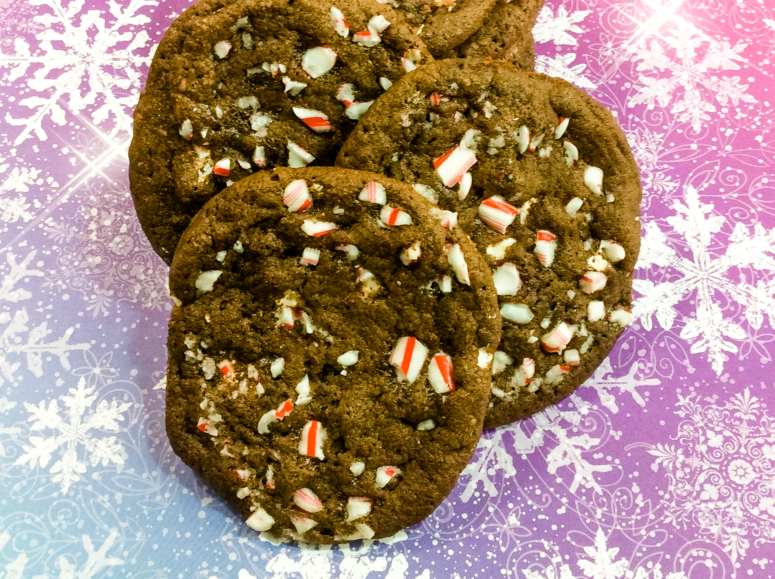 What would be better than Hot Chocolate Cookies that bake up soft, thick and tastes just like hot chocolate? Hot Chocolate cookies that are topped with chocolate chips and crushed candy canes. These Peppermint Hot Chocolate Cookies are perfect all season long.