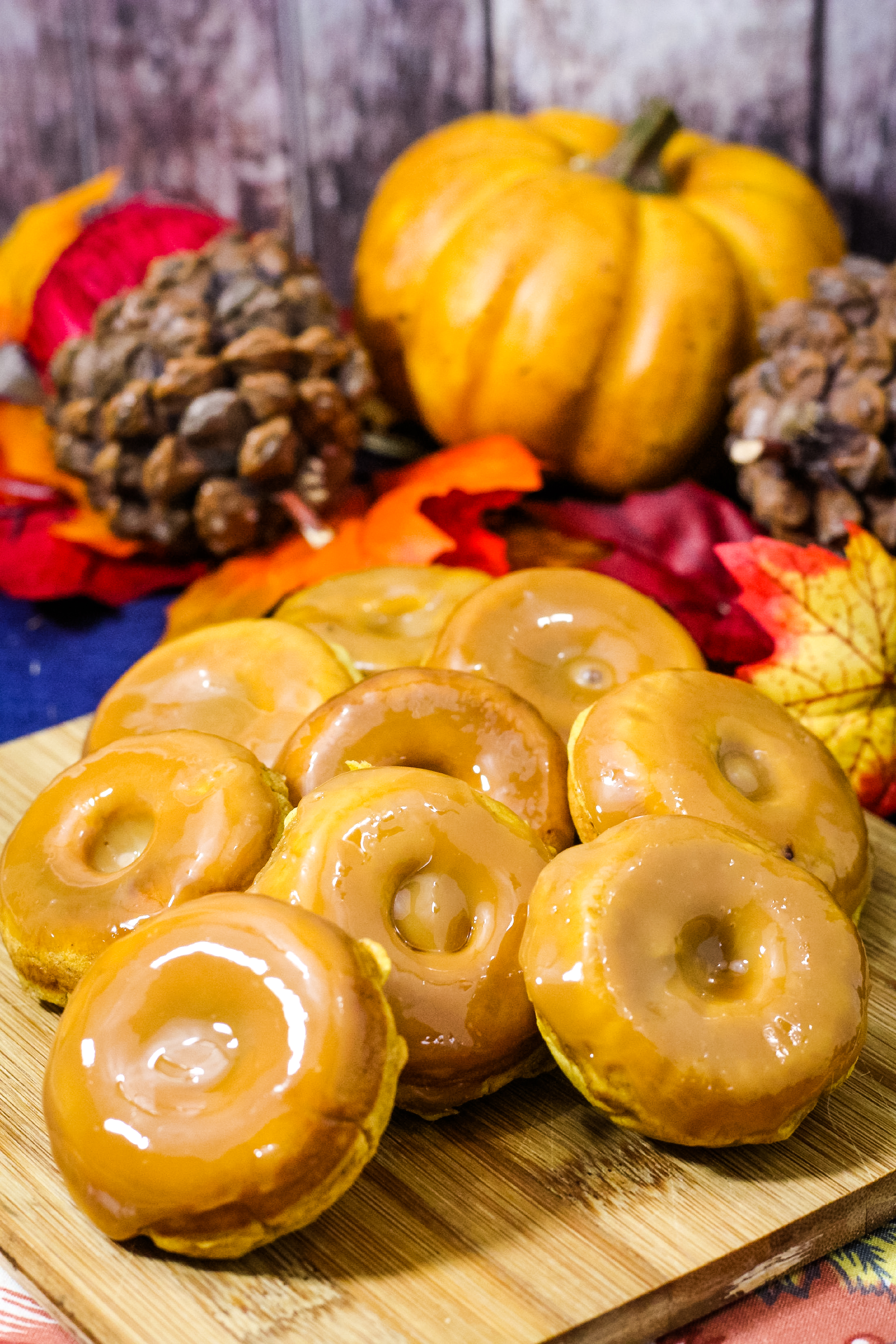 Looking for a delicious pumpkin donut recipe? These baked mini donuts are the perfect sized pumpkin treat. Filled with pumpkin spice flavor, these donuts are glazed to perfection. #pumpkin #treat #breakfast #donuts