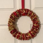 Looking for a simple DIY Christmas craft? This simple Christmas wreath is made from materials found at the dollar store and only costs $6 and a few minutes to make.