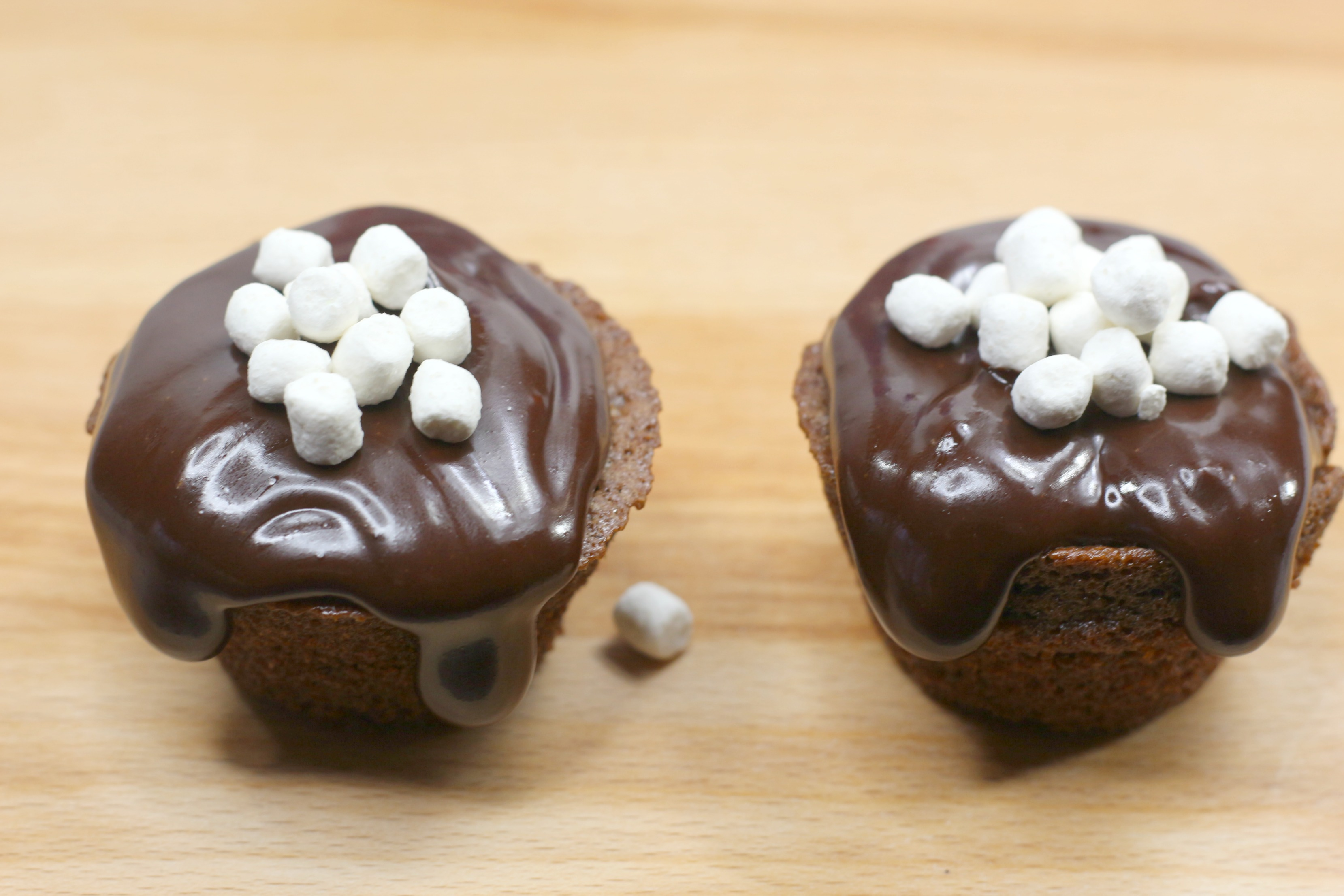 hot chocoa cupcakes with marshmallows on top