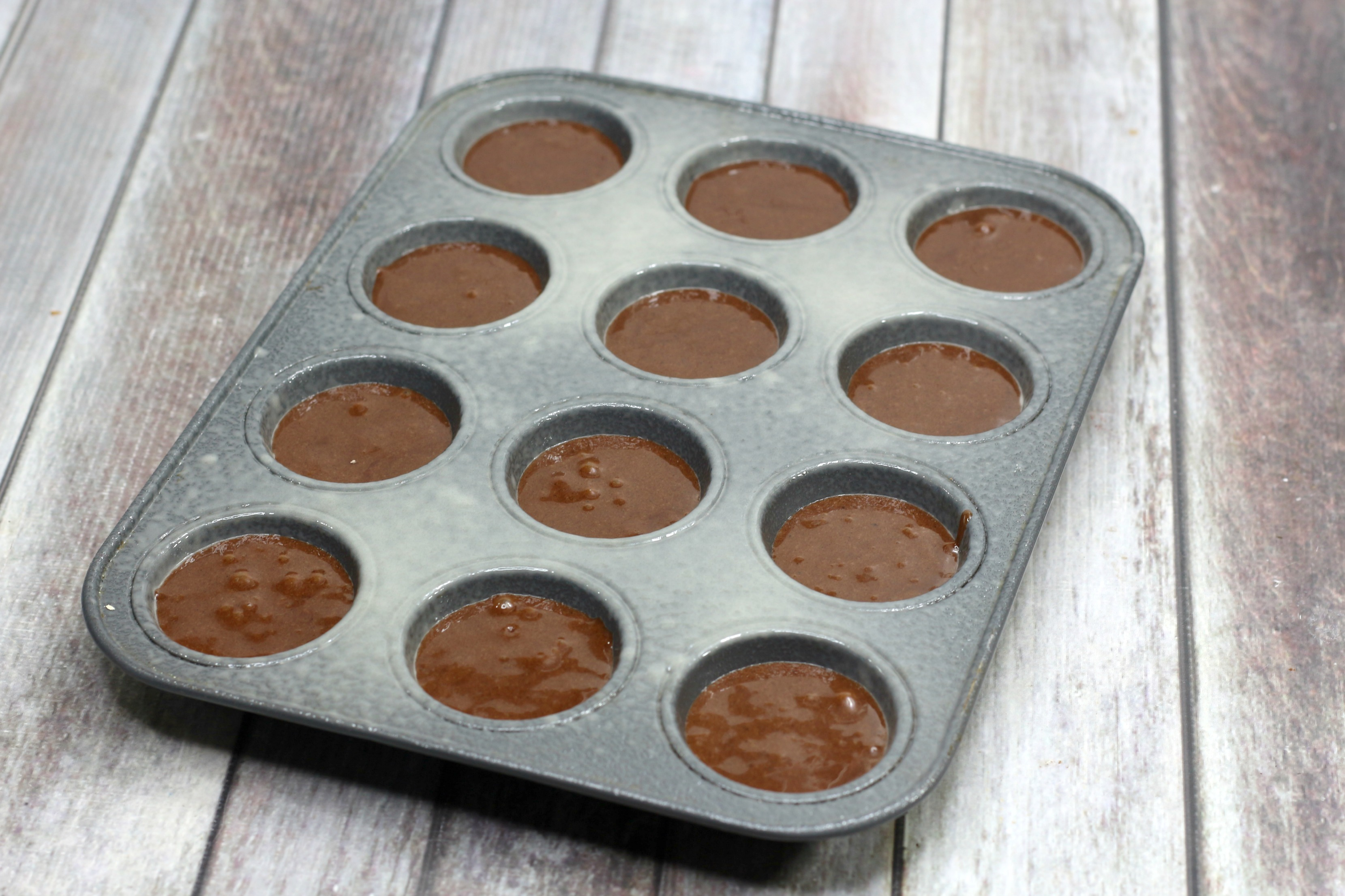 brownie mix cupcakes in the cupcake tin