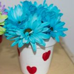 blue flowers in white flow pot craft