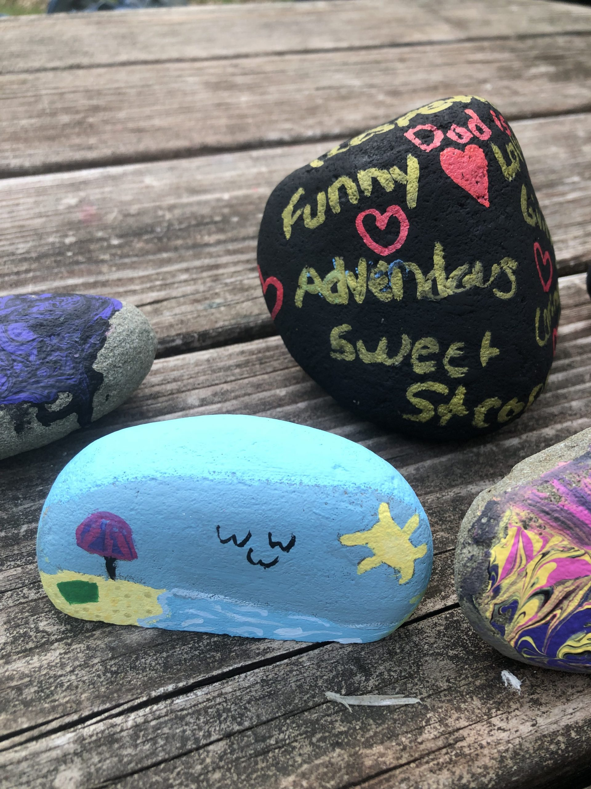 """Looking for a fun and easy Father's Day craft. With these rocks, you get to tell Dad just how special he is. Make """"My Dad Rocks"""" rocks and see how much he smiles. It is an easy and inexpensive Father's Day gift kids can make themselves."""