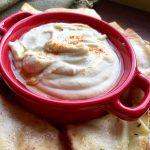white bean dip in a red bowl