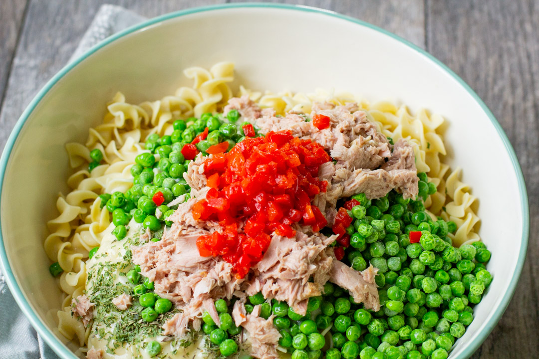 all ingredients in a bowl for tuna noodle casserole