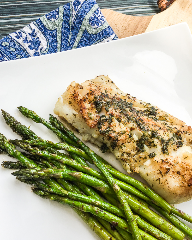 easy cod recipe on a plate with asparagus