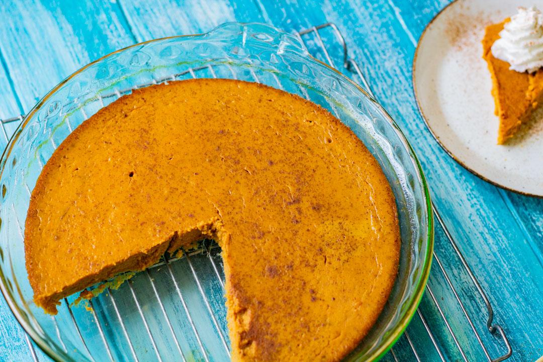 crustless pumpkin pie with piece missing