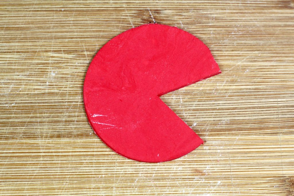 red fondant circle with mouth cut out