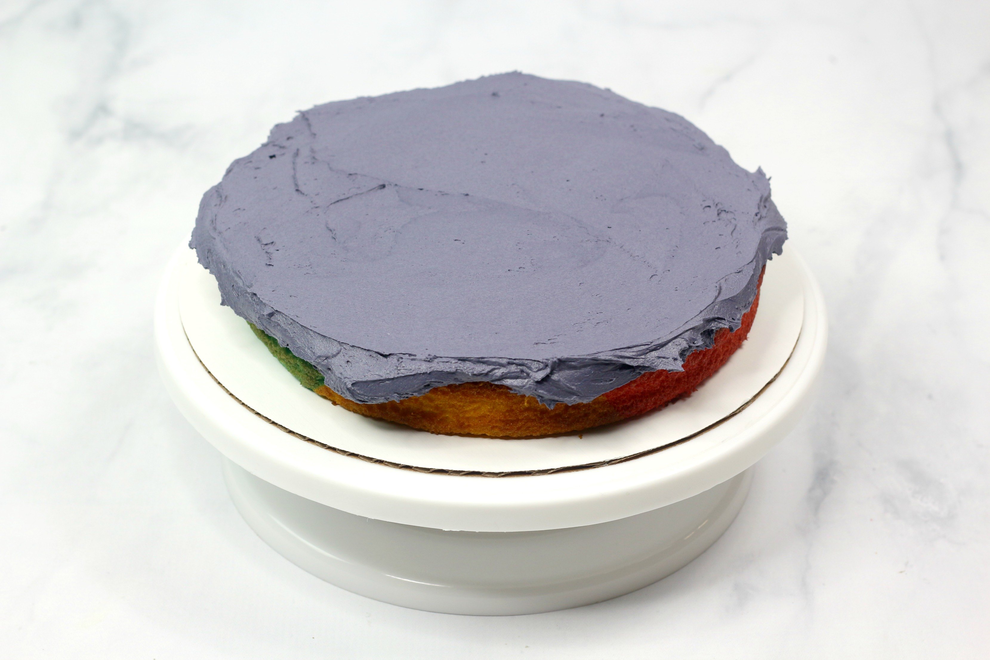 spread the icing over the layer cake