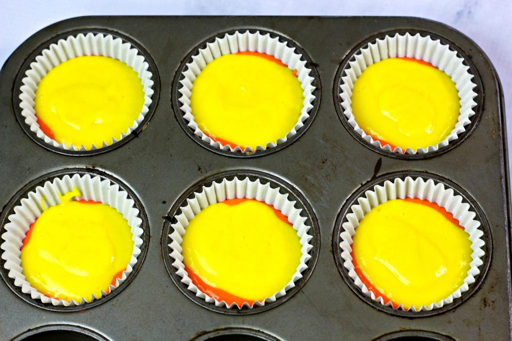 yellow cake batter on top of orange batter
