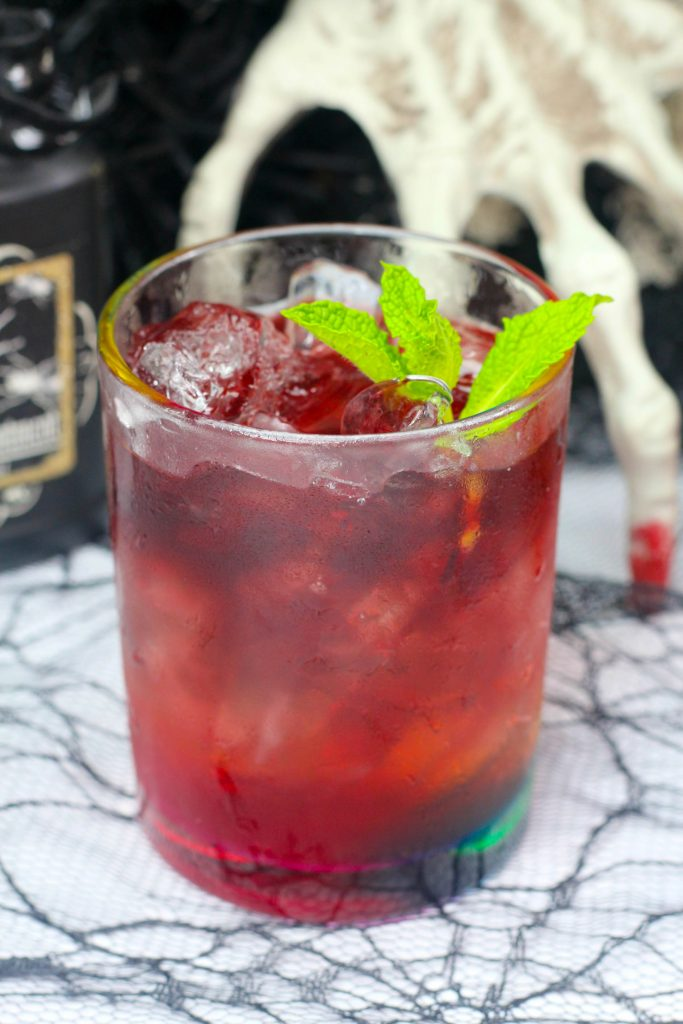 witch's brew cocktail with mint sprig
