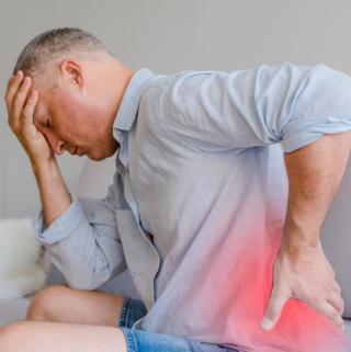 man bent over in pain