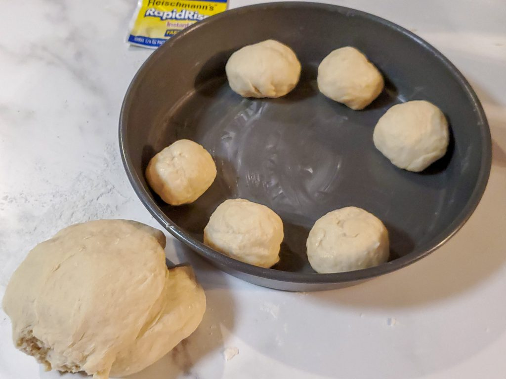 rolls in a pan and dough balls for homemade rolls
