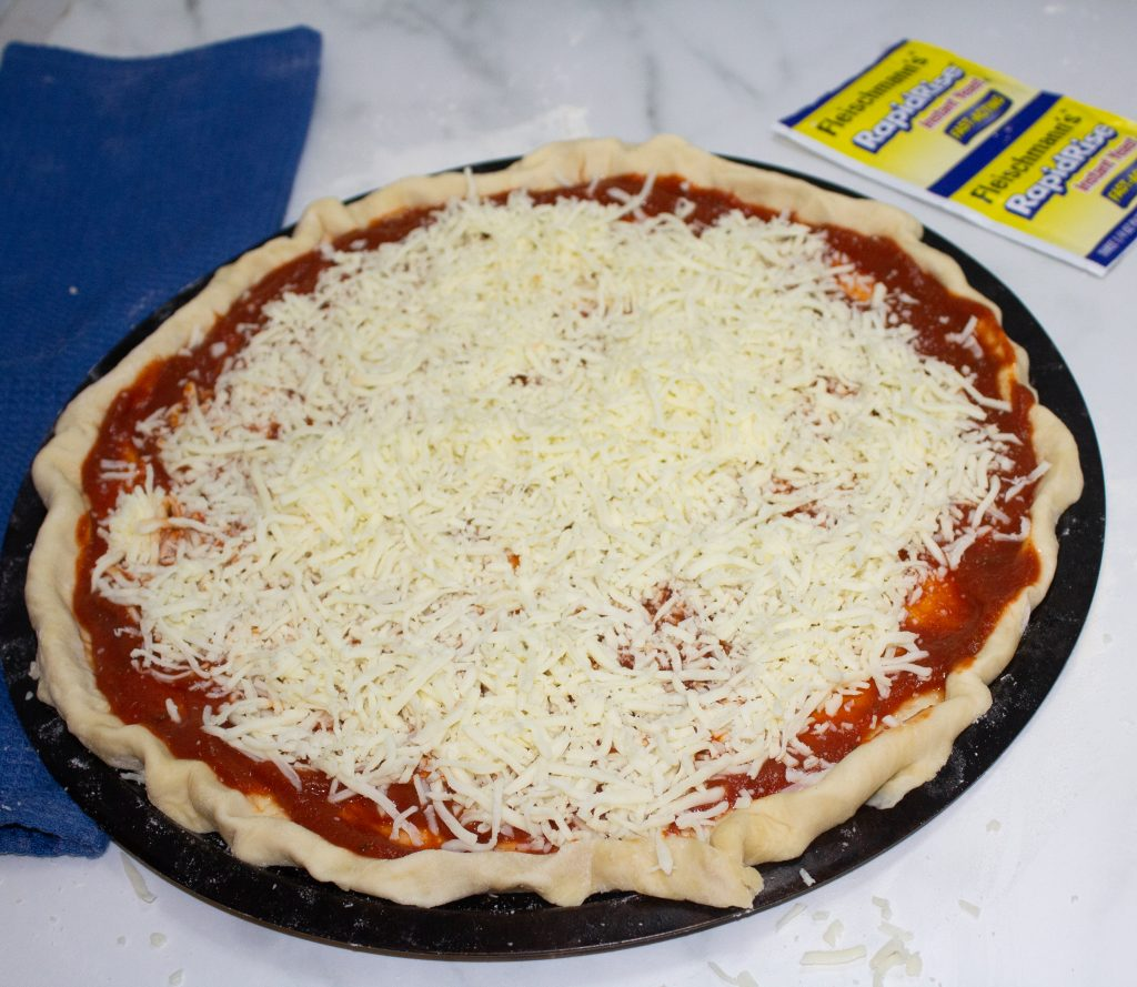 cheese over a homemade pizza