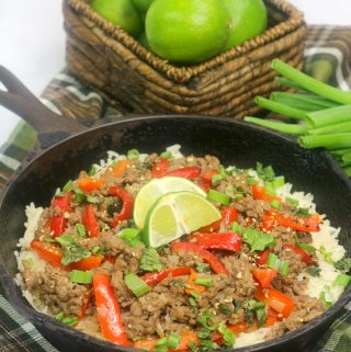 thai basil beef in a cast iron skiller