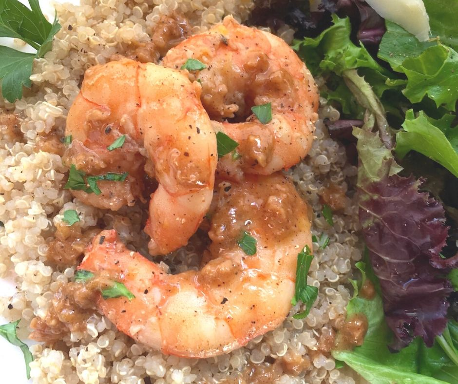 lemon garlic shrimp on a plate with salad