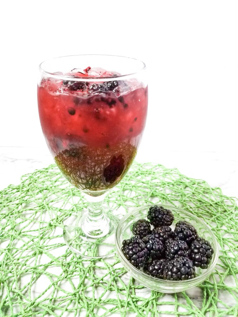 Blackberry Margaritias with blackberries on a green mat