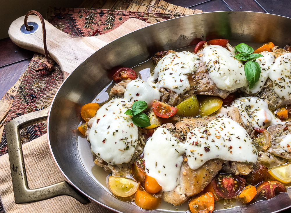 Mozzarella Stuffed Chicken Breast in a skillet
