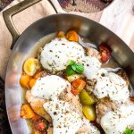 Mozzarella Stuffed Chicken Breast with vegetables in a skillet