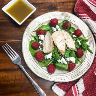 raspberry salad with a side of dressing