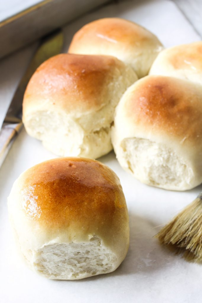 homemade rolls on a white surface