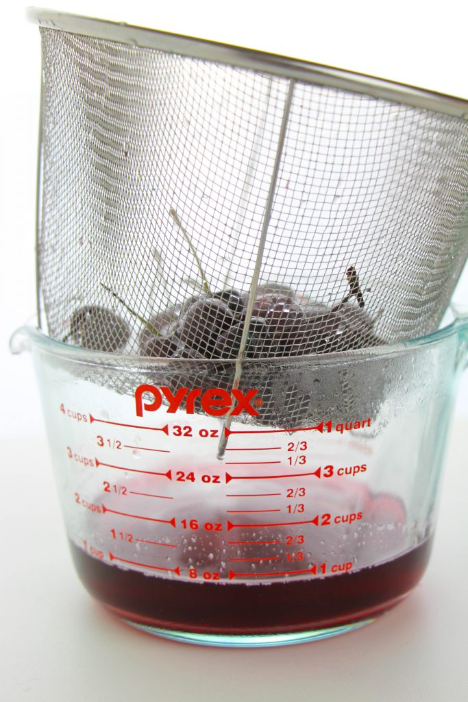 cherries in a strainer
