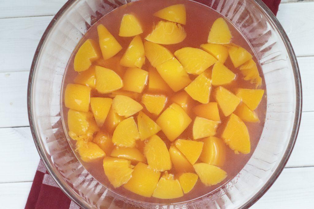 jello and peaches in a bowl
