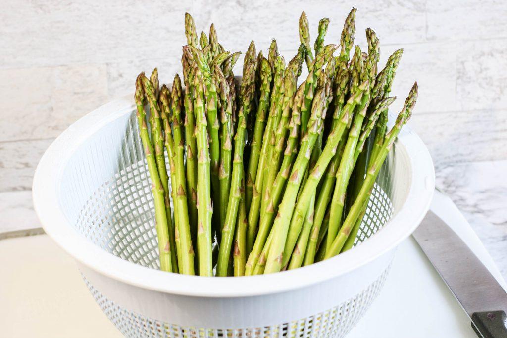 Air Fryer Asparagus in a strainer