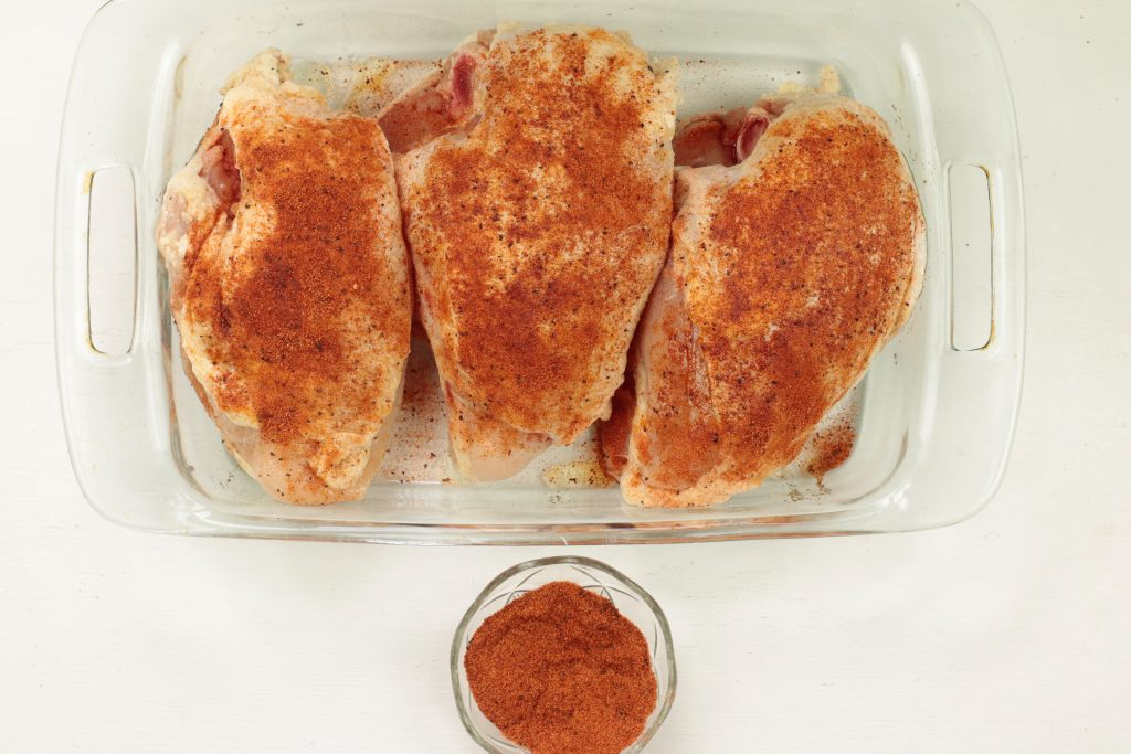 chicken in a pan with seasoning